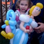 girl holding baloons