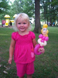 Girl with balloon animal