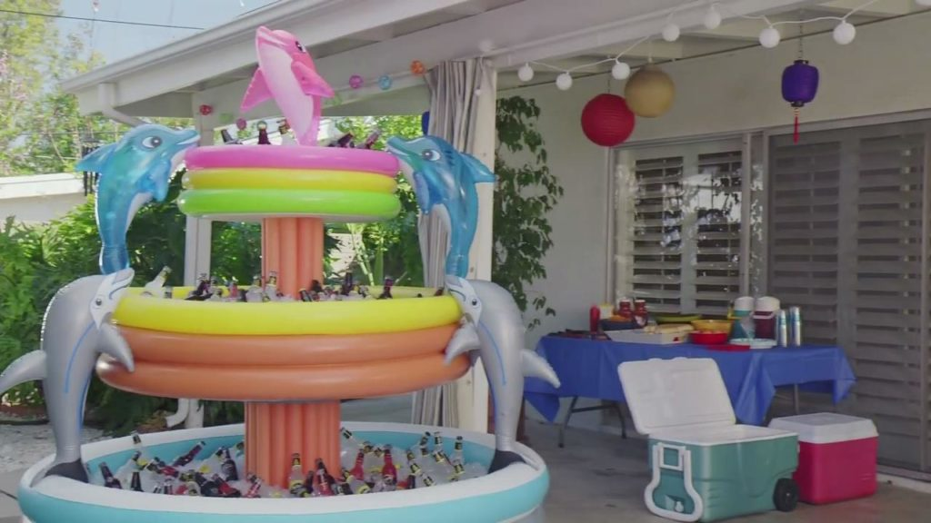 Mikes Hard Lemonade Ad that has a pool cooler at a childs birthday party