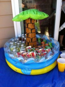 kiddy pool used as a kids cooler for s 1st birthday party.