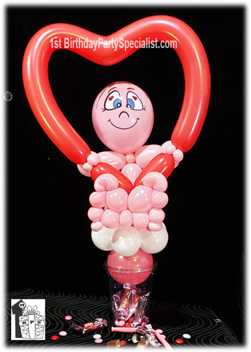 Valentine's Day Candy Cups - person holding a valentine's day balloon heart.